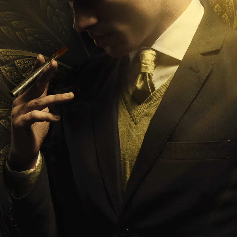 Man dressed in tuxedo with golden tie holding MISTIFI Premium Cannabis Vape Pen