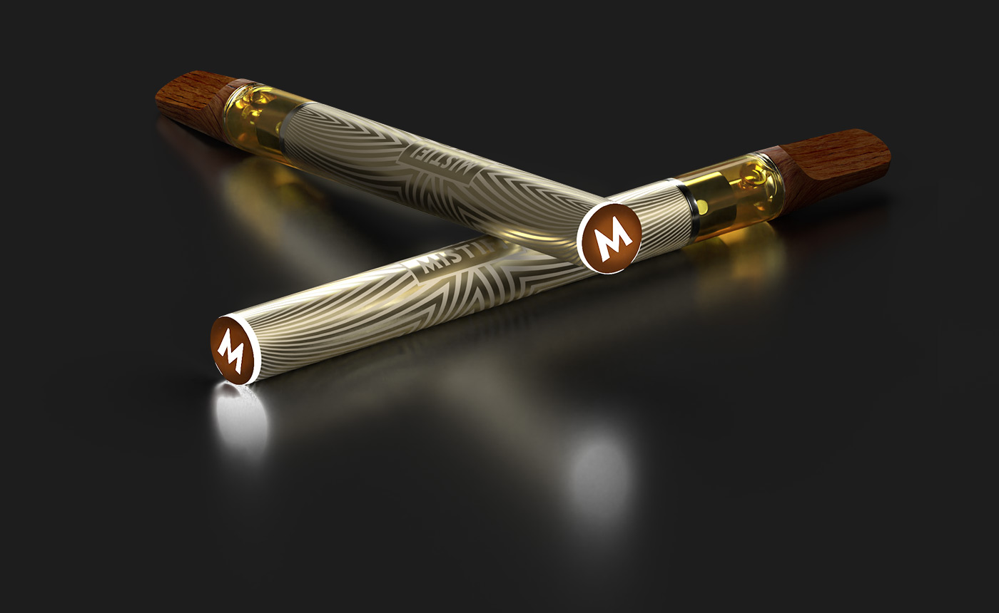 Two MISTIFI Premium Cannabis Vape Pens laying crossed on dark background glowing M indicator